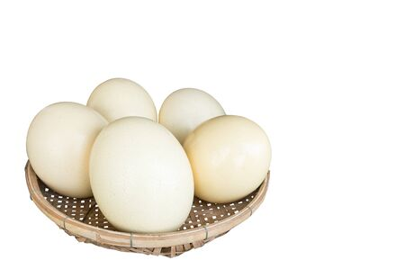 solidify: Isolated of Ostrich eggs in the basket Stock Photo