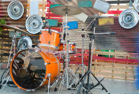 alloy: The drums , stage is decorated by alloy wheels, Retro style Stock Photo
