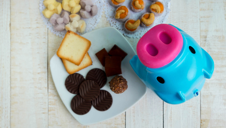 Pig is a symbol of obese people, Many dessert on wooden