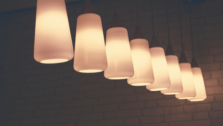 led lighting: lighting of lamps, The Ceiling Fixture on brick wall background.
