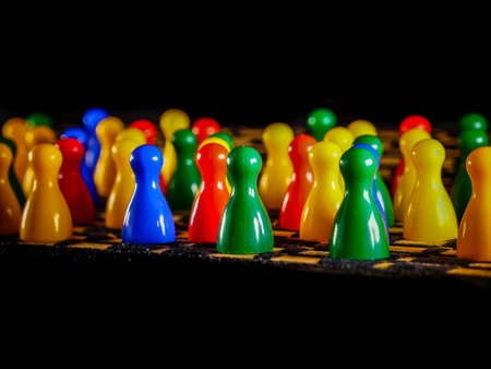 Colorful figures for ludo family board game isolated