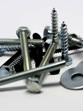 Close-up of various steel nuts and bolts