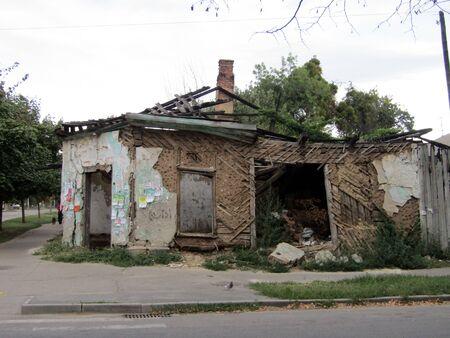 dangerous old ruined house waiting for demolition in Ukraine, Poltava. stock photo