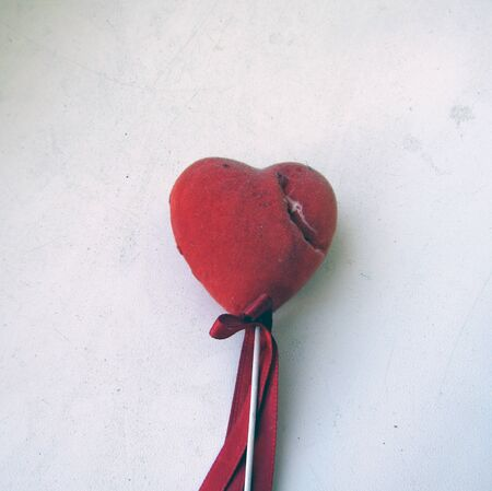 shabby red heart on a stick. stock photo