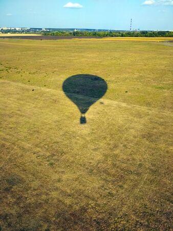 balloon shadow on green field. Stock photo