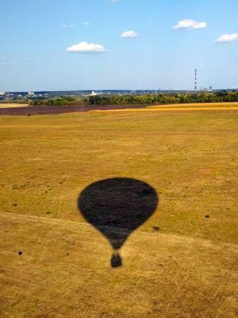 balloon shadow on yellow field. Stock photo