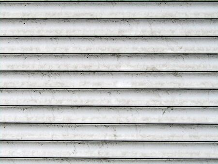dirty closed white shutters. background. stock photo