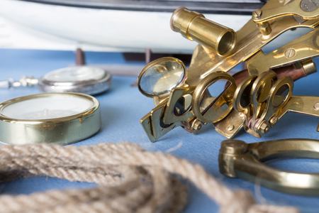 Various pieces of nautical equipment on blue background Imagens