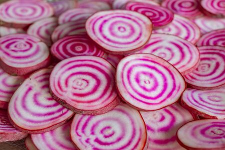 Closeup of sliced Chioggia beets Imagens