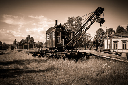 An old crane wagon in a derelict rail yard Imagens