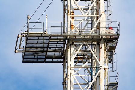 Closeup of a white construction crane platform