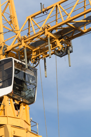 Closeup of a construction crane cabin and trolley Imagens