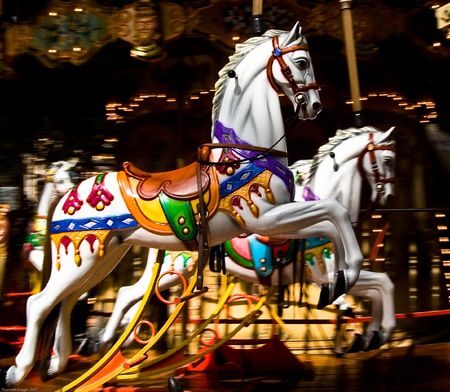 Two colourful wooden carousel horses taken in Provence France Stock Photo