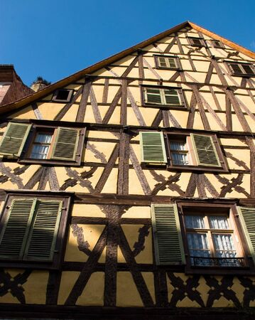 Traditional timber frame and stucco house in Riquewihr, , Alsace, France Stock Photo