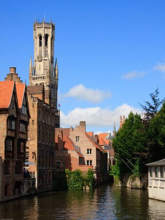 De Rozenhoedkaai (Quai of the Rosary) Bruges with The Belfry of Bruges, or Belfort in the background. Stock Photo