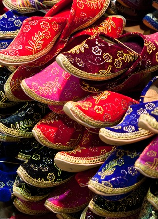 A pile of brigthly colored slippers taken in Istanbul, Turkey Stock Photo
