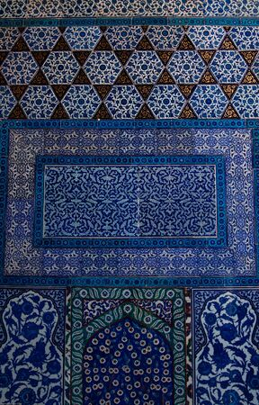 Traditional blue and white colorful tiles on a wall in the Topkapi Palace of the Sulatan, Istanbul, Turkey Stock Photo
