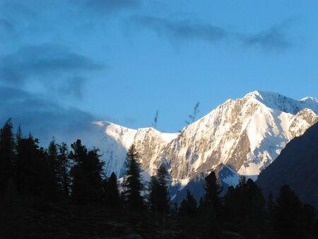 Gorgeous mountainous landscape. Crown of Altai summit in clouds. Katun Mountain range. Altai Republic, Siberia, Russia.
