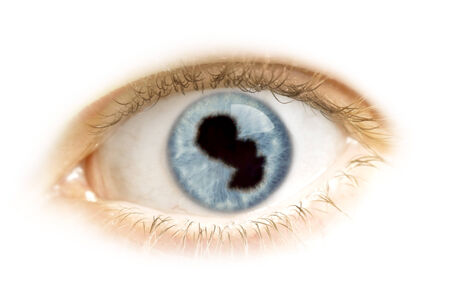 visions of america: A close-up of an eye with the pupil in the shape of Paraguay.(series) Stock Photo