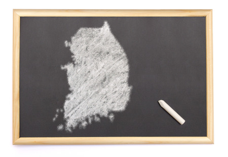 Blackboard with a chalk and the shape of South Korea drawn onto. (series) photo