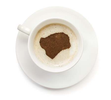 A cup of coffee with foam and powder in the shape of Guinea-Bissau.(series) photo