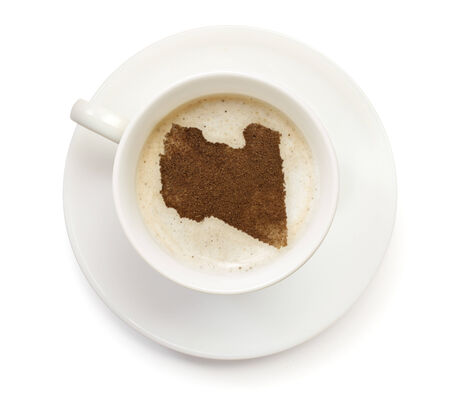 A cup of coffee with foam and powder in the shape of Libya.(series) photo