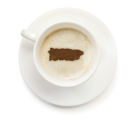 A cup of coffee with foam and powder in the shape of Puerto Rico.(series)