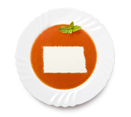 A plate tomato soup with cream in the shape of North Dakota.(series) photo