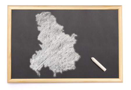 serbia and montenegro: Blackboard with a chalk and the shape of Serbia Montenegro drawn onto. (series)