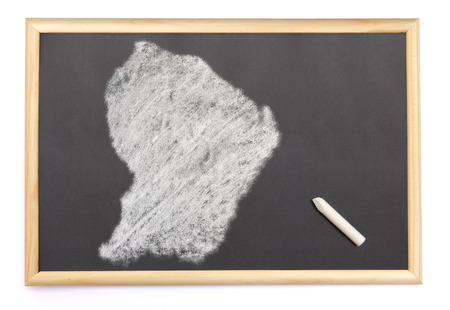 Blackboard with a chalk and the shape of French Guiana drawn onto. (series) photo