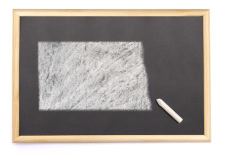 Blackboard with a chalk and the shape of North Dakota drawn onto. (series) photo