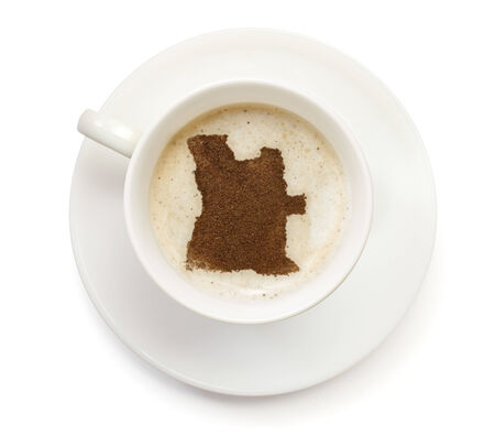 A cup of coffee with foam and powder in the shape of Angola.(series) photo