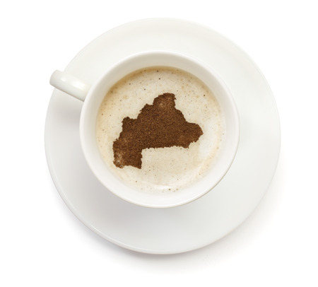 A cup of coffee with foam and powder in the shape of Burkina Faso.(series) photo