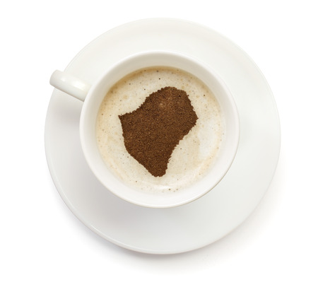 A cup of coffee with foam and powder in the shape of Burundi.(series) photo