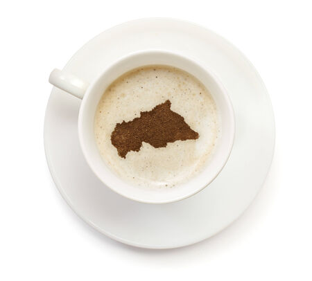 A cup of coffee with foam and powder in the shape of Central African Republic.(series) photo