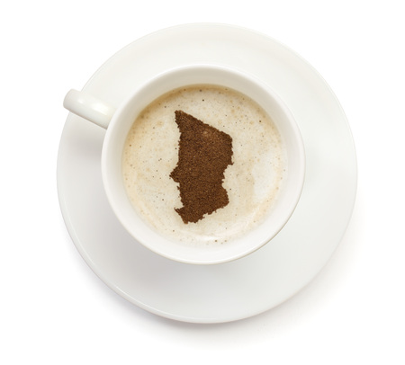 A cup of coffee with foam and powder in the shape of Chad.(series) photo