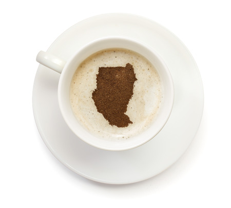 A cup of coffee with foam and powder in the shape of Sudan.(series) photo