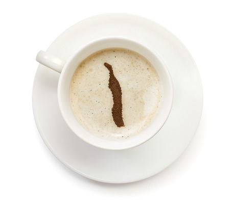 A cup of coffee with foam and powder in the shape of Togo.(series) Reklamní fotografie