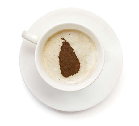 A cup of coffee with foam and powder in the shape of Sri Lanka.(series) photo