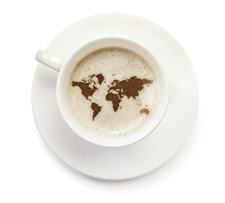 A cup of coffee with foam and powder in the shape of World.(series) photo
