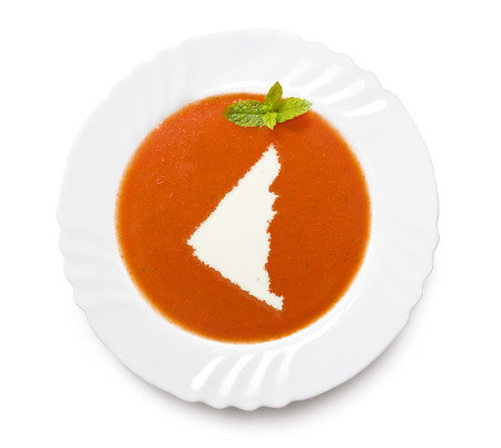 A plate tomato soup with cream in the shape of Yukon.(series) photo