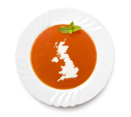 uk cuisine: A plate tomato soup with cream in the shape of United Kingdom.(series)