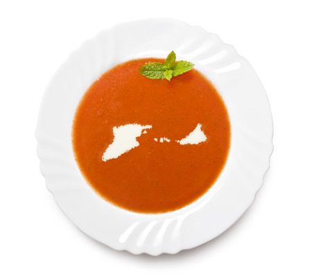 midway: A plate tomato soup with cream in the shape of Midway Islands.(series) Stock Photo