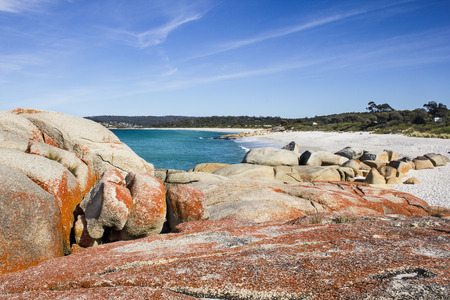 Lonelsy scenic rock formation at Bay of Fires in Tasmania with beautiful sea in the background photo