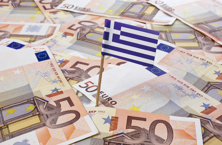 the economy: Flag of Greece sticking in european banknotes.(series)
