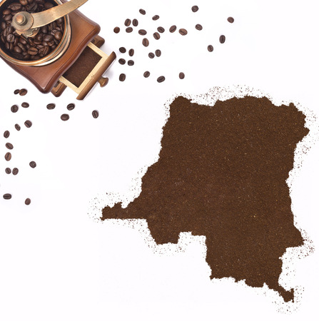 Coffee powder in the shape of Democratic Republic of the Congo and a decorative coffee mill.(series) photo