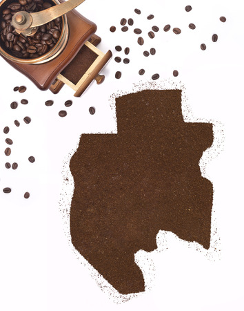 Coffee powder in the shape of Gabon and a decorative coffee mill.(series) photo