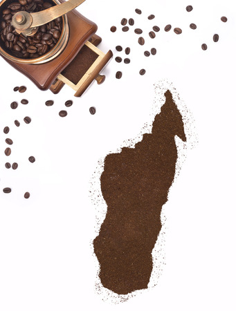 kibble: Coffee powder in the shape of Madagascar and a decorative coffee mill.(series)