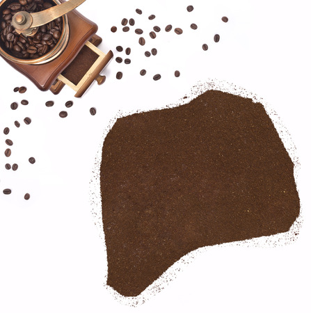Coffee powder in the shape of Rwanda and a decorative coffee mill.(series) photo