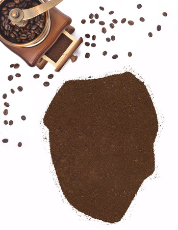kibble: Coffee powder in the shape of Sierra Leone and a decorative coffee mill.(series)